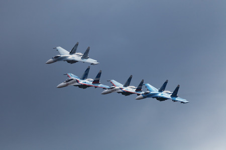 aerobatics: NIZHNY TAGIL, RUSSIA - SEP 25, 2013: The international exhibition of armament, military equipment and ammunition RUSSIA ARMS EXPO (RAE-2013). The participants of the air show Falcons Of Russia - aviation group aerobatics of the air forces of Russia on t