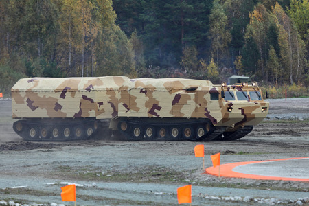 tracked: NIZHNY TAGIL, RUSSIA - SEP 25, 2013: The international exhibition of armament, military equipment and ammunition RUSSIA ARMS EXPO (RAE-2013). Two-tier tracked all-terrain amphibian vehicle