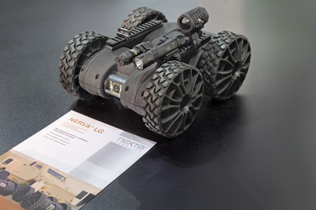 defuse: NIZHNY TAGIL, RUSSIA - SEP 25, 2013: The international exhibition of armament, military equipment and ammunition RUSSIA ARMS EXPO (RAE-2013). Remote controlled robot Nerva LG French company Nexter Robotics for contact detection and neutralization of IEDs