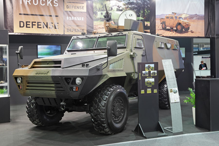 industrially: NIZHNY TAGIL, RUSSIA - SEP 25, 2013: The international exhibition of armament, military equipment and ammunition RUSSIA ARMS EXPO (RAE-2013). Modern French armored car Bastion Patsas production Acmat