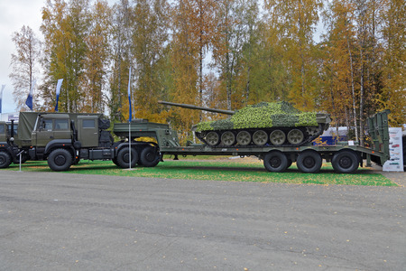 industrially: NIZHNY TAGIL, RUSSIA - SEP 25, 2013: The international exhibition of armament, military equipment and ammunition RUSSIA ARMS EXPO (RAE-2013). Semi-heavy-duty vehicle automobile for transportation of armored vehicles Editorial