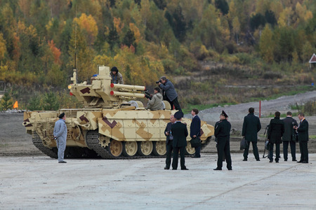 armament: NIZHNY TAGIL, RUSSIA - SEP 25, 2013: The international exhibition of armament, military equipment and ammunition RUSSIA ARMS EXPO (RAE-2013). Customers visiting BMPT Ramka - Russian Tank Support Fighting Vehicle Terminator