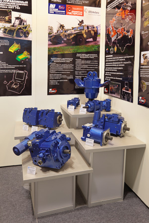 electromechanical: NIZHNY TAGIL, RUSSIA - SEP 27, 2013: The international exhibition of armament, military equipment and ammunition RUSSIA ARMS EXPO (RAE-2013). Stand JSC Kovrov electromechanical plant (KEMP). Hydraulic pumps and motors