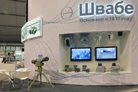 observational: NIZHNY TAGIL, RUSSIA - SEP 26, 2013: The international exhibition of armament, military equipment and ammunition RUSSIA ARMS EXPO (RAE-2013). Stand holding Shvabe, high-tech optical-electronic systems and complexes