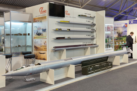 armament: NIZHNY TAGIL, RUSSIA - SEP 26, 2013: The international exhibition of armament, military equipment and ammunition RUSSIA ARMS EXPO (RAE-2013). Stand scientific-Production Association SPLAV. Jet missiles of various purposes for systems of volley fire Editorial