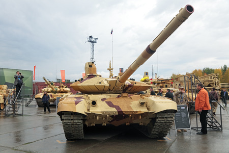 armament: NIZHNY TAGIL, RUSSIA - SEP 26, 2013: The international exhibition of armament, military equipment and ammunition RUSSIA ARMS EXPO (RAE-2013). The T-90 Russian third-generation main battle tank Editorial