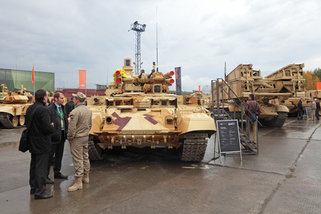 terminator: NIZHNY TAGIL, RUSSIA - SEP 26, 2013: The international exhibition of armament, military equipment and ammunition RUSSIA ARMS EXPO (RAE-2013). Customers visiting BMPT Ramka - Russian Tank Support Fighting Vehicle Terminator