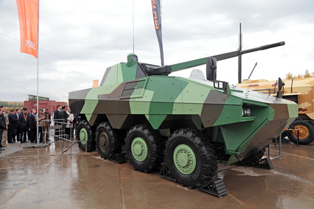 """armament: NIZHNY TAGIL, RUSSIA - SEP 26, 2013: The international exhibition of armament, military equipment and ammunition RUSSIA ARMS EXPO (RAE-2013). Heavy wheeled infantry fighting vehicles Atom, joint development of Russian enterprise UralVagonZavod"""" and F"""