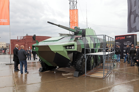 "armament: NIZHNY TAGIL, RUSSIA - SEP 26, 2013: The international exhibition of armament, military equipment and ammunition RUSSIA ARMS EXPO (RAE-2013). Heavy wheeled infantry fighting vehicles Atom, joint development of Russian enterprise UralVagonZavod"" and F"