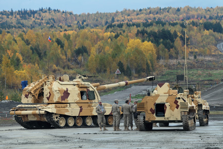 armament: NIZHNY TAGIL, RUSSIA - SEP 26, 2013: The international exhibition of armament, military equipment and ammunition RUSSIA ARMS EXPO (RAE-2013). Russian heavy self-propelled 152 mm howitzer 2S19 Msta-S