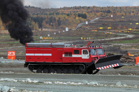 armament: NIZHNY TAGIL, RUSSIA - SEP 26, 2013: The international exhibition of armament, military equipment and ammunition RUSSIA ARMS EXPO (RAE-2013). Caterpillar fire truck to extinguish forest fires Editorial