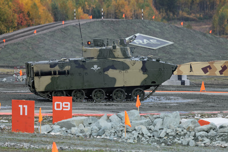 showpiece: NIZHNY TAGIL, RUSSIA - SEP 26, 2013: The international exhibition of armament, military equipment and ammunition RUSSIA ARMS EXPO (RAE-2013). The arborne fighting vehicle BMD-4M Editorial