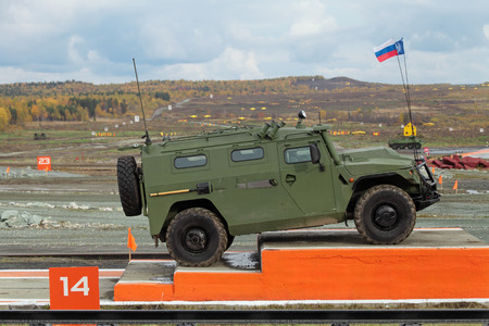 armament: NIZHNY TAGIL, RUSSIA - SEP 26, 2013: The international exhibition of armament, military equipment and ammunition RUSSIA ARMS EXPO (RAE-2013). GAZ Tigr is a Russian 4x4, multipurpose, all-terrain infantry mobility vehicle