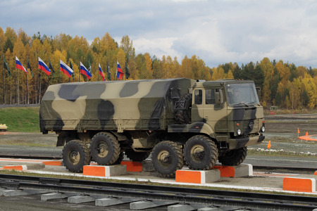 industrially: NIZHNY TAGIL, RUSSIA - SEP 26, 2013: The international exhibition of armament, military equipment and ammunition RUSSIA ARMS EXPO (RAE-2013). The Ural-5323 is a 8x8 heavy-duty off-road truck specially designed for army service