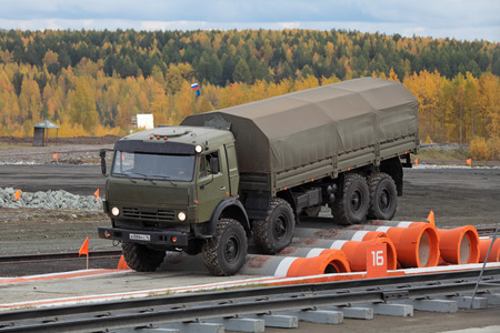 unified: NIZHNY TAGIL, RUSSIA - SEP 26, 2013: The international exhibition of armament, military equipment and ammunition RUSSIA ARMS EXPO (RAE-2013). KAMAZ 6350 - unified military multipurpose 8x8 all-wheel drive truck on the obstacle course