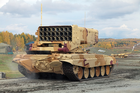industrially: NIZHNY TAGIL, RUSSIA - SEP 26, 2013: The international exhibition of armament, military equipment and ammunition RUSSIA ARMS EXPO (RAE-2013). Russian Heavy Flame Thrower System, multiple rocket launcher TOS-1