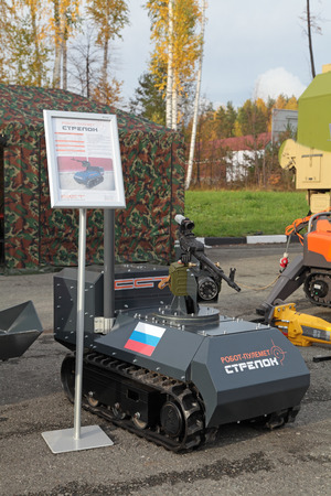 remote controlled: NIZHNY TAGIL, RUSSIA - SEP 26, 2013: The international exhibition of armament, military equipment and ammunition RUSSIA ARMS EXPO (RAE-2013). Remote controlled tracked robot machine gun