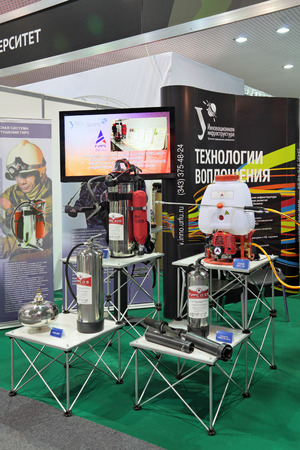 respiratory apparatus: NIZHNY TAGIL, RUSSIA - SEP 25, 2013: The international exhibition of armament, military equipment and ammunition RUSSIA ARMS EXPO (RAE-2013). Portable fire-extinguishing systems Editorial
