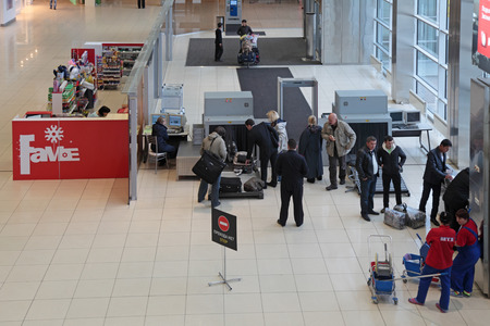 detector: YEKATERINBURG, RUSSIA - SEP 28: Increased security measures. Screening of passengers at the entrance to the building of the airport Koltsovo