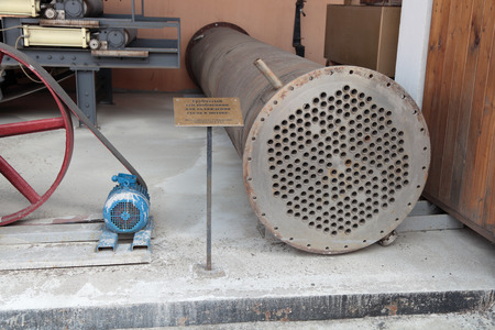 tubular: MOSCOW, RUSSIA, OCHAKOVO BREWERY - JUN 13: The exposition of retro-equipment for brewing. Old tubular heat exchanger for cooling of wort in the stream