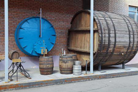 showpiece: MOSCOW, RUSSIA, OCHAKOVO BREWERY - JUN 13: The exposition of retro-equipment for brewing. Old barrels for aging beer