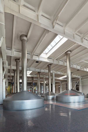 company premises: MOSCOW, RUSSIA, OCHAKOVO BREWERY - JUN 13, 2013: The biggest Russian company beer and beverage industry. The interior of the brewery, mash vats Editorial