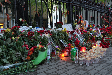 affliction: MOSCOW, RUSSIA - MAY 05, 2014: Flowers and candles near the Embassy of Ukraine, which laid the grieving Russians due to with the tragic events in city Odessa