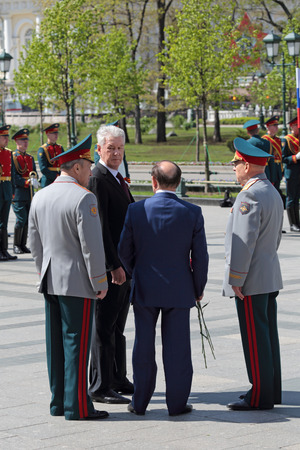 the statesman: MOSCOW, RUSSIA, - MAY 8, 2014: Measures of Moscow Sergey Sobyanin at the ceremony of laying flowers to the monument Tomb of the Unknown Soldier in Alexander Garden. Festive events dedicated to the 69th Anniversary of Victory Day (WWII)