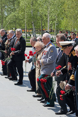 generals: MOSCOW, RUSSIA - MAY 8, 2014: Military servicemen, officials and war veterans at the ceremony of laying flowers to the Tomb of the Unknown Soldier in Alexander garden. Festive events dedicated to the 69th Anniversary of Victory Day (WWII) Editorial