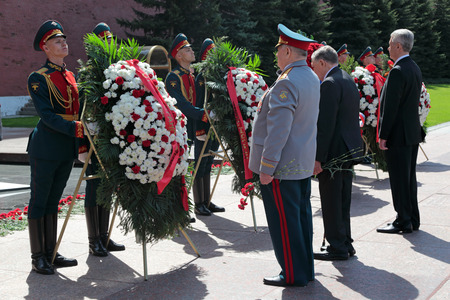MOSCOW, RUSSIA - MAY 8, 2014: A wreaths and red carnations assigned to the monument Tomb of the Unknown Soldier in Alexander Garden. Festive events dedicated to the 69th Anniversary of Victory Day (WWII)