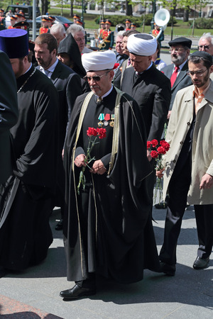 cleric: MOSCOW, RUSSIA - MAY 8, 2014: Members of the clergy at the ceremony of laying flowers to the Tomb of the Unknown Soldier in Alexander garden. Festive events dedicated to the 69th Anniversary of Victory Day (WWII)