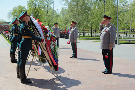 assigned: MOSCOW, RUSSIA - MAY 8, 2014: A wreaths and red carnations assigned to the monument Tomb of the Unknown Soldier in Alexander Garden. Festive events dedicated to the 69th Anniversary of Victory Day (WWII)