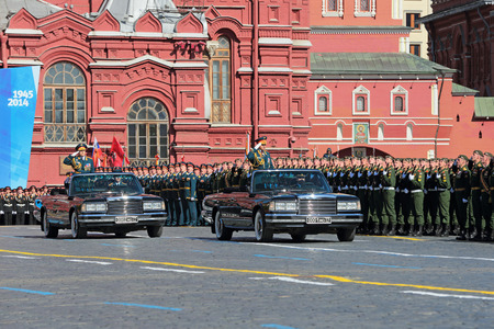 solemn land: MOSCOW, RUSSIA - MAY 09, 2014: Celebration of the 69th anniversary of the Victory Day (WWII) on Red Square. Chief of Land forces of Russia Oleg Salyukov and Minister of defence of the Russian Federation Sergey Shoygu