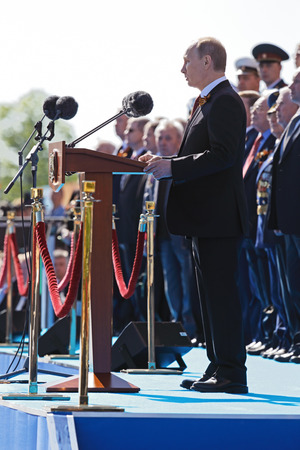 triumphant: MOSCOW, RUSSIA - MAY 09, 2014: Celebration of the 69th anniversary of the Victory Day (WWII) on Red Square. President Vladimir Putin congratulates the audience Editorial