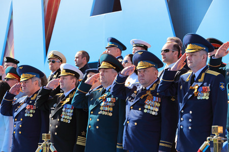 generals: MOSCOW, RUSSIA - MAY 09, 2014: Celebration of the 69th anniversary of the Victory Day (WWII) on Red Square. The leadership of the Ministry of defense of Russia on the VIP tribune