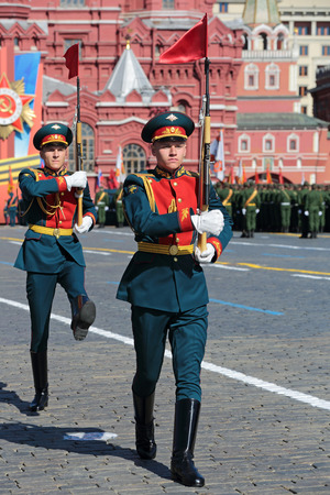 regiment: MOSCOW, RUSSIA - MAY 09, 2014: Celebration of the 69th anniversary of the Victory Day (WWII). Solemn marching of soldiers in Red Square. Guard of honor Kremlin Regiment (also called Presidential Regiment) is a unique military regiment, it is a part of the