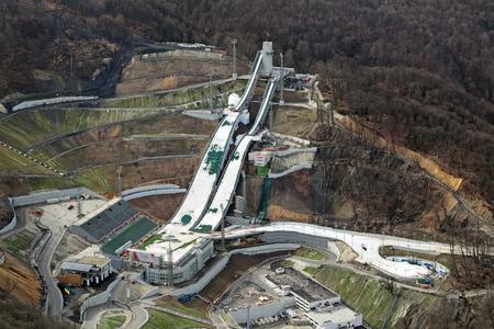 gorki: SOCHI, RUSSIA - MAR 02, 2014: Krasnaya Polyana - alpine ski Resort, venue for the 2014 winter sports competitions. The RusSki Gorki Jumping Center, top view Editorial