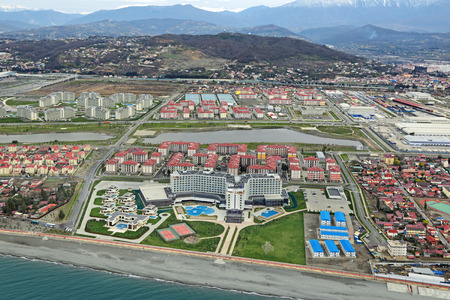 highlands region: SOCHI, ADLER, RUSSIA - MAR 02, 2014: Modern hotel complexes on Olympic Prospekt near Olympic Park in Adlersky District, Krasnodar Krai, top view
