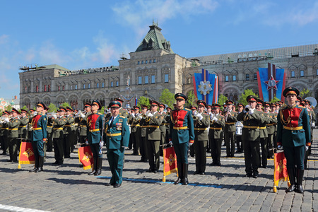 anthem: MOSCOW, RUSSIA - MAY 09, 2014: Celebration of the 69th anniversary of the Victory Day (WWII). Solemn passage of military hardware on Red Square. A military band plays the national anthem