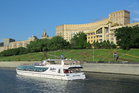 MOSCOW, RUSSIA - MAY 17, 2013: View on Moscow river and Rostovskaya embankment. The Radisson pleasure boat floats on the river. Radisson Hotels & Resorts is an international hotel company with more than 420 locations in 73 countries.