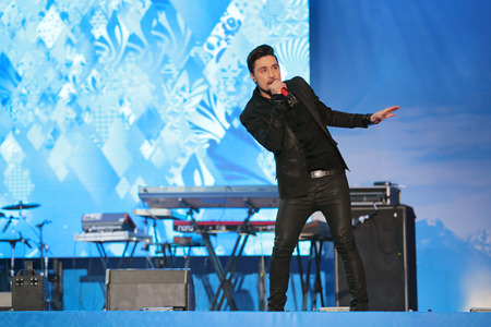 paralympic: SOCHI, RUSSIA - MAR 5, 2014: Singer Dima Bilan at the lighting ceremony of the Paralympic flame in the mountain ski resort Rosa Khutor, Krasnaya Polyana