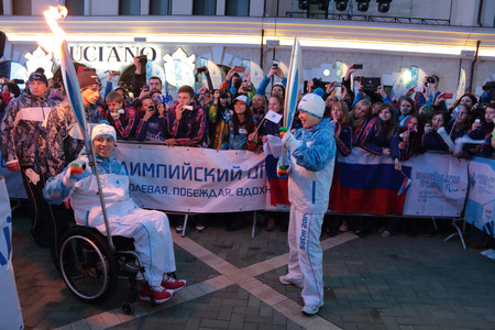 mikhail: ROSA KHUTOR, SOCHI, RUSSIA - MAR 5, 2014: The transfer ceremony of the Paralympic flame President of the Paralympic Committee of Russia Mikhail Terentyev 13-fold Paralympic champion Rima Batalova