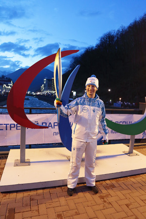 paralympic: ROSA KHUTOR, SOCHI, RUSSIA - MAR 5, 2014: Party relay of the Paralympic flame, head of the communication service of the organizing Committee of Sochi-2014 Roman Osin