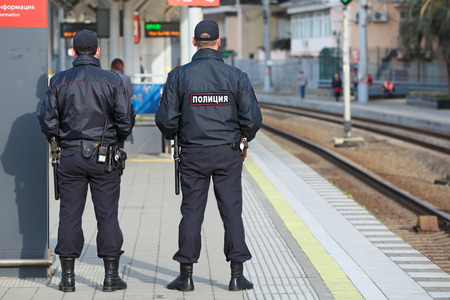 increased: SOCHI, RUSSIA - MAR, 8, 2014: The two police officers patrols the railway station Hosta. Increased security measures because of the sports competition winter games
