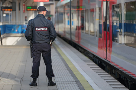 SOCHI, RUSSIA - MAR, 3, 2014: The police officer patrols the railway station Hosta. Increased security measures because of the Olympic winter games