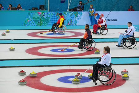 SOCHI, RUSSIA - MAR 8, 2014: Paralympic winter games in curling center Ice cube, wheelchair curling, the round Robin, session 1