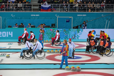 paralympic: SOCHI, RUSSIA - MAR 8, 2014: Paralympic winter games in curling center Ice cube, wheelchair curling, the round Robin, session 1