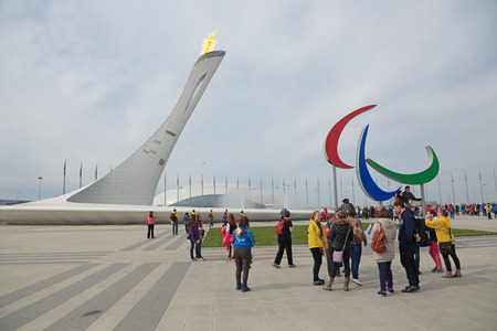 olympiad: SOCHI, RUSSIA - MAR 8, 2014: Burning Paralympic flame and Agitos at the Olympic Park, the Olympic winter games 2014