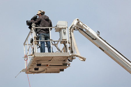 reportage: MOSCOW REGION, SERGIYEV POSAD, RUSSIA - JUL 18, 2014:  Videographer produces video report from the height of a crane on a celebration of the 700th anniversary of the birthday of St. Sergius of Radonezh Editorial