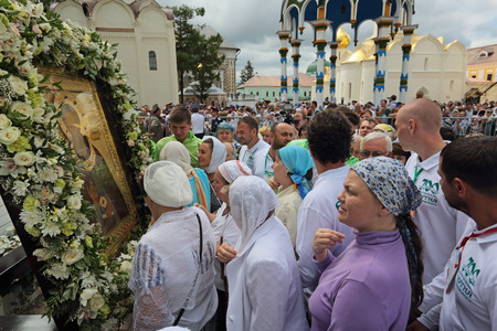veneration: MOSCOW REGION, SERGIYEV POSAD, RUSSIA - JUL 18, 2014: Trinity Lavra of St. Sergius. Celebration of the 700th anniversary of the birthday of St. Sergius of Radonezh. Pilgrims bow down before the icon of Sergius of Radonezh Editorial